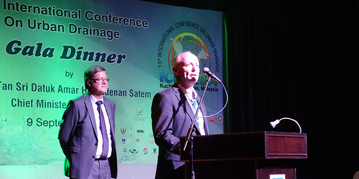 Peter Steen Mikkelsen at his acceptance speech during the ICUD gala dinner 9th September 2014, in front of the JCUD chair Prof. David Butler, Exeter University, UK.