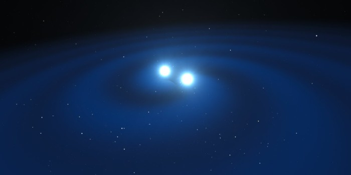 Circling neutron stars as imagined by artist (Illustration: ESO/L. Calçada/M. Kornmesser)